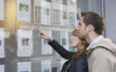 couple looking in estate agents