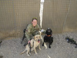 Military officer with dogs