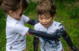 Children partaking in messy play