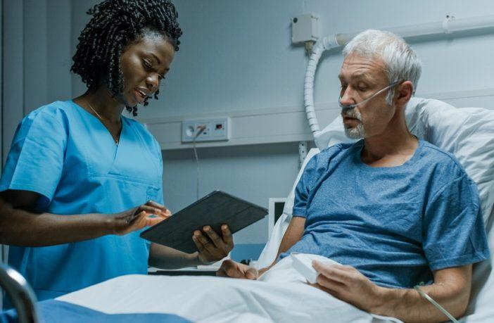 Nurse tending to patient