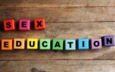 Letter blocks spelling 'sex education'
