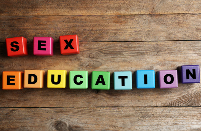 Letter blocks spelling 'sex education'