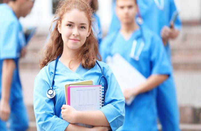 two nurses holding paperwork