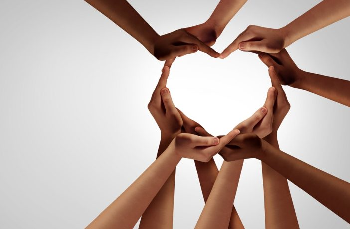 Hands connected in a heart shape