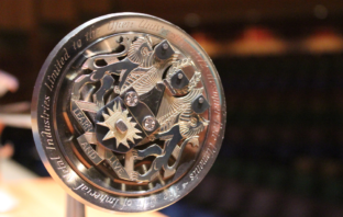 An image of the inscription on the The Open University Ceremonial Mace