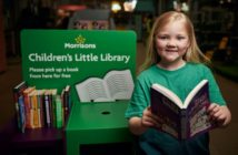 Child pictured next to the Morrisons' Children's Little Library