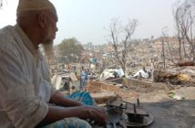 An elderly Rohingya Refugee man looks out upon the devastation caused by the fires that burned down the homes of thousands in April 2021 Photo by Mohamned Zobair