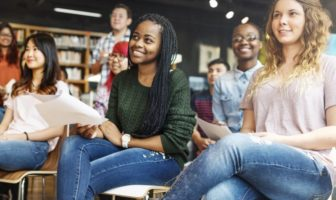 University students listening to a speaker