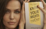 Actress, Angelina Jolie holding a copy of the book, Know Your Rights and Claim Them