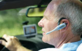 man driving while on phone