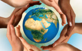 Hands surrounding a globe